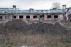 Abandoned farmhouse near castle ruins. Derelict and abandoned farmhouse on a stormy day Royalty Free Stock Photography