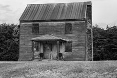 Abandoned Farmhouse in a Rural Field Royalty Free Stock Photography