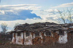 Abandoned farmhouse on a stormy day. Derelict and abandoned farmhouse on a stormy day Royalty Free Stock Image