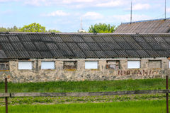Abandoned farmhouse on a stormy day. Derelict and abandoned farmhouse on a stormy day Stock Photos