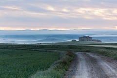 Abandoned farmhouse in Tuscany at sunrise Stock Images