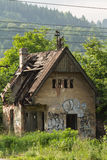 Abandoned farmhouse in Zilina, Slovakia under the trees Royalty Free Stock Images