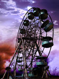 Abandoned ferris wheel. Old, broken and abandoned ferris wheel under sunset Stock Photography