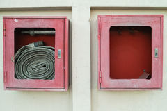 Abandoned fire hose cases. The abandoned old fire hose cases found on the wall shown that not care has been taken of stock image