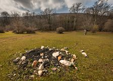 Abandoned fireplace on a meadow in Croatia on a partly cloudy day in spring. Abandoned fireplace on a meadow in Croatia Island Cres on a partly cloudy day in Royalty Free Stock Photography