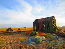 Abandoned Fishermans Hut covered in old nets Stock Photography