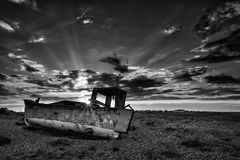 Abandoned fishing boat on beach black and white landscape at sun. Abandoned fishing boat on shingle beach black and white landscape at sunset Royalty Free Stock Images