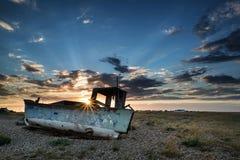 Abandoned fishing boat on beach landscape at sunset Royalty Free Stock Image