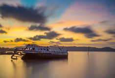 Abandoned fishing boat with beautiful sunset in the east, Thaila Royalty Free Stock Images