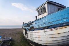 Abandoned fishing boat ruin on beach during lovely Summer mornin Stock Image