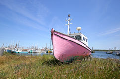 Abandoned Fishing Boat Sitting on Shore - Newfoundland, Canada Royalty Free Stock Photos