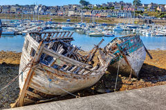 Abandoned fishing boats on the beach. Stock Photos