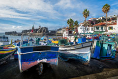 Abandoned fishing boats laying on the shore in Camara de Lobos marina Stock Photography