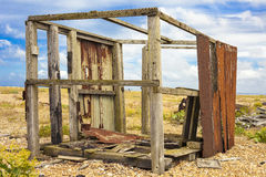 Abandoned fishing hut. Abandoned fishing hut or old wooden cabin on south coast of England in Dungeness Stock Photos