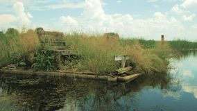 Abandoned fishing spot on the water. In summer stock footage