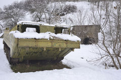 Abandoned floating conveyor at the entrance to a nuclear shelter Stock Image