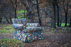 Abandoned floral fabric chair Stock Photography