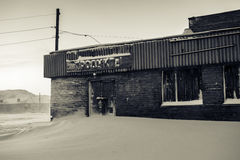 Abandoned food store with the label in russian language. Teriberka settlement, Murmansk Region, Russia. Translation of the text from Russian is `food Royalty Free Stock Photography
