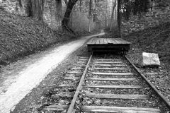 Abandoned forest railroad. High dynamic range, monochromatic image of old abandoned railroad next to the path in the forest. Lock Ridge Park located in royalty free stock image