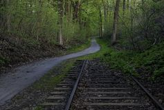 Abandoned forest railroad. Old abandoned railroad next to the path in the forest. Lock Ridge Park located in Pennsylvania stock images