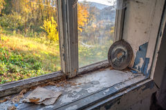 Abandoned forgotten house. Broken window in old abandoned house Royalty Free Stock Images