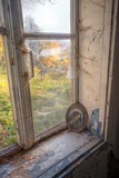 Abandoned forgotten house. Broken window in old abandoned house Stock Photo
