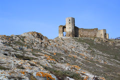 Abandoned fortress. On top a rocky hill Stock Image