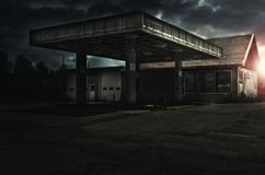 Abandoned freaking old gas station, sunset in background. Photo manipulation Royalty Free Stock Photography