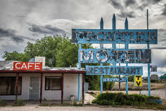 Abandoned Frontier Motel on historic route 66 in Arizona. TRUXTON, ARIZONA, USA - MAY 18, 2016 : Abandoned Frontier Motel, Cafe and vintage neon sign on historic stock image