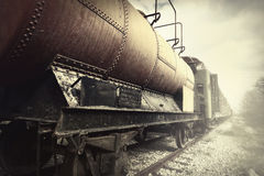 Abandoned fuel and passenger train Stock Photography