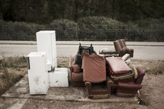 Abandoned furniture and fridges in the street and forest Royalty Free Stock Images