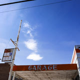 Abandoned Garage. In Nevada town with lettering and blue skies with clouds Royalty Free Stock Photography