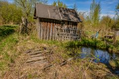 Abandoned garden plots in the spring. Collapsed wooden buildings. Abandoned plots Stock Images