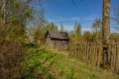 Abandoned garden plots in the spring. Collapsed wooden buildings. Abandoned plots Stock Photography