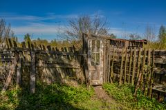 Abandoned garden plots in the spring. Collapsed wooden buildings. Abandoned plots Royalty Free Stock Photo