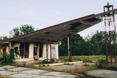 Abandoned Gas Station with Broken Windows stock photos