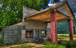 Abandoned Gas Station Burton, Texas. Abandoned gas station with red brick columns and metal tin siding photographed on the Back Roads of Texas in Burton Texas royalty free stock image
