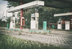 Abandoned Gas Station close-up. Abandoned gas station showing overgrown fuel pumps Royalty Free Stock Photography