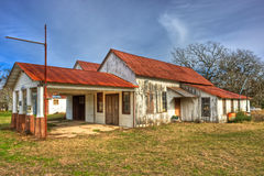 Abandoned Gas Station Rek Hill Community, Texas. Abandoned wood framed gas station and garage with rusted metal tin roof photographed near the Rek Hill Community royalty free stock photos