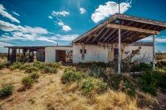Abandoned gas station rots away under the Arizona Sun stock photography