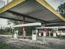 Abandoned Gas Station. Showing overgrown fuel pumps Royalty Free Stock Photo