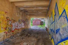 Abandoned gateway overlooking the iron garage Royalty Free Stock Image