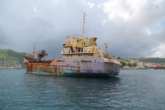 An abandoned general cargo ship `Anina` built 1970 and left to rust in the Bay of St. George`s Grenada Royalty Free Stock Photos