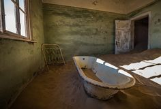 Abandoned ghost town of Kolmanskop in Namibia Stock Images