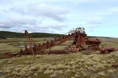 Abandoned gold mine at lake Lago Blanco. Royalty Free Stock Images
