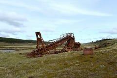 Abandoned gold mine at lake Lago Blanco. Stock Photos