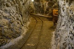 Old Gold Mine Rail Tracks. Abandoned gold mine train tracks winding through the caves one mile underground stock photography