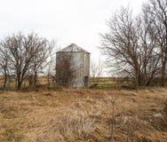 Abandoned grain bin on winter day Royalty Free Stock Image