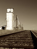 Abandoned Grain Elevator. Vista up the tracks and beyond the abandoned grain elevator in the ghost town of First View, Colorado Royalty Free Stock Photo