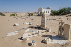 Abandoned graveyard with crumbling stones and crosses in Namib Desert of Angola Stock Photos